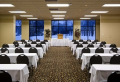 Bayhill Room with chairs and tables setup for a conference