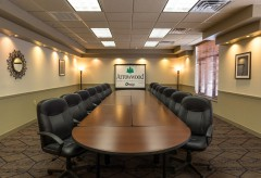 Sandhill Large boardroom with a large table and chairs surrounding it