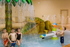 Children playing in waterpark area