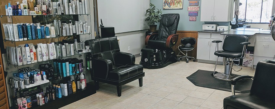 Salon overview, lots of hair products and a location for hair cuts and styles
