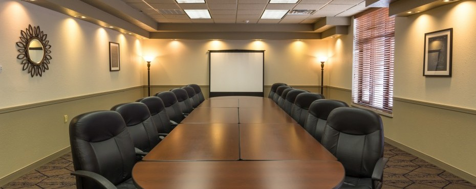 Sandhill Meeting Room setup in a u shape with coffee cups and glasses for each spot