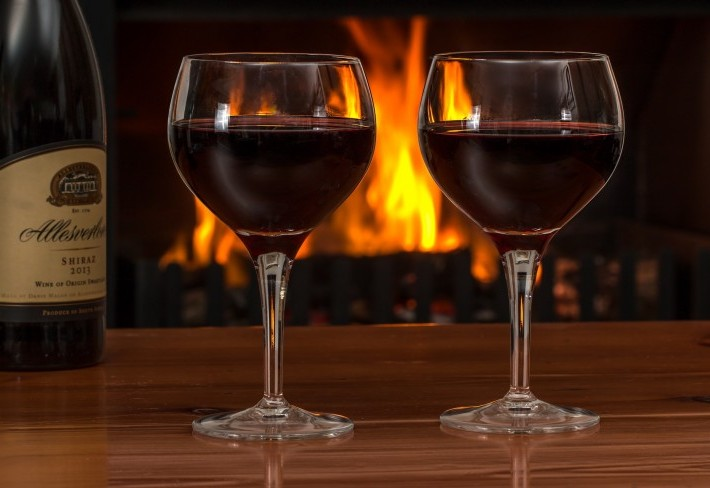 two wine glasses in front of fire place